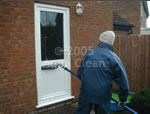 An Aqua Clean cleaner cleaning one of our customers uPVC doors