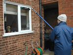 An Aqua Clean cleaner cleaning one of our customers windows